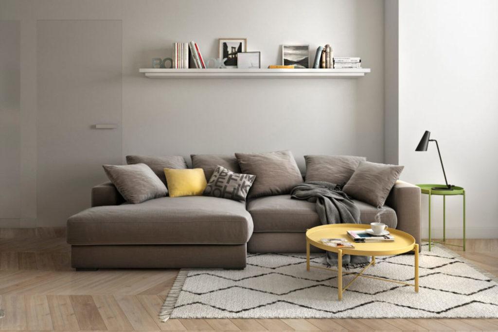 Комфортный диван-кровать в дизайне гостиной